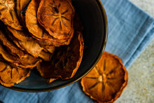Sliced, Dried And Dehydrated Persimmon Fruit In A Bowl