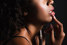 Cropped View Of Sexy African American Woman Touching Lips Isolated On Black