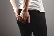 Young Woman Has Hemorrhoids