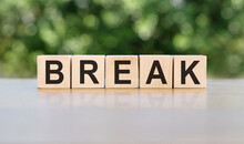 BREAK Word Written On Wooden Blocks. The Text Is Written In Black Letters And Is Reflected In The Mirror Surface Of The Table. Business Concept For Your Design.