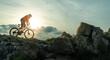 canvas print picture - Mountainbiker fährt in den Bergen