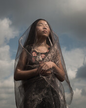 Portrait Of Girl Dreaming In Nature Under Thin Fabric In Sun Light