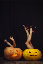 Female Legs And Arms Sticking Out Of Huge Orange Pumpkins, Creepy Halloween Poster Background