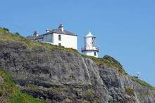 Blackhead Lighthouse Located At Clifftop Near Whitehead, County Antrim, Northern Ireland