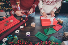 Cropped Photo Of Two Handy Grandparents Prepare Packing Presents Wear Ornament Pullover Home Indoors
