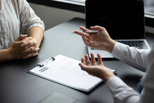 A Female Job Applicant Attending A Job Interview With A HR Manager For An Accounting Position At A Company, HR Manager Reviewing A Job Applicant's Resume, Job Interview Ideas And Recruiting.
