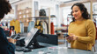 canvas print picture - Clothing Store Checkout Cashier Counter: Woman Retail Sales Manager Accept NFC Smartphone and Credit Card Payments from a Young Female Customers for Clothes.