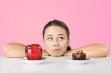 Portrait Of Attractive Funny Cheerful Hungry Girl With Fresh Dessert