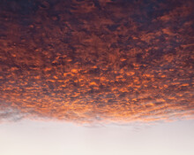 Dramatic Cloudscape At Sunset With Red Clouds On Sky