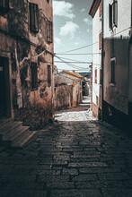 Vertical Shot Of A Path Between Aged Buildings Of Rovinj In Croatia