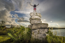 Person Standing On Multiple Rocks At The Fakahatchee Strand State Preserve In Florida, USA