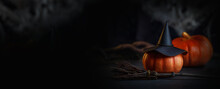 The Mystical Room Of The Witch. A Decorative Photo For Halloween With A Hat, Pumpkins And A Broom. Banner In Black And Orange Colors.