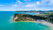 Aerial View On A Rocky Cliff With A Beautiful Harbour On The Background. Coromandel, New Zealand.