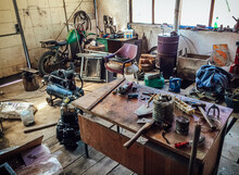 Workshop Scene, Interior Of An Old Dirty Garage Full Of Stuff. Old Messy Mechanics Workshop With Different Types Of Scattered Tools.