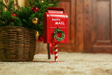 Red Post Box For Letters To Santa Claus Near The Christmas Tree