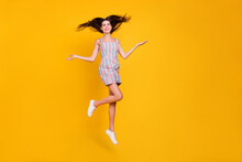 Full Length Body Size Woman Smiling Jumping High Happy Throwing Hair Cheerful Isolated Vivid Yellow Color Background
