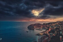 Travel To Croatia. Aerial Night Image Of Summer Sky. Popular Tourist Destination In Hrvatska, Dubrovnik Has Hundreds Of Tourists To Take Pictures Of The Medieval Fortification That Has Become Iconic