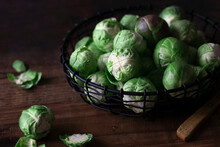 Raw Brussel Sprouts On A Wooden Background.