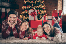 Photo Of People Family Lay Floor Relax Comfortable Place Wear Sweater In Decorated X-mas Home Indoors