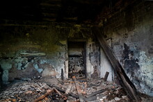 An Abandoned Building To Be Demolished, With Sooty Walls And A Collapsed Plank Ceiling, After A Fire.