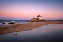 Senhor Da Pedra Iconic Chapel On The Beach In Miramar, Portugal