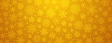 Christmas Background Of Big And Small Complex Snowflakes In Yellow Colors