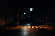 Closeup Shot Of A Pedestrian Under The Street Lights During The Night