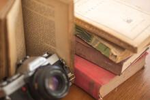 Vintage Camera Old Typewriter And Literature Books On Wood Table