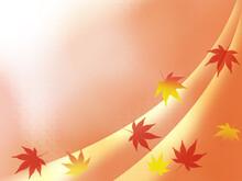 オレンジ色の背景に色づいた紅葉の葉っぱの落葉