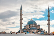 Two Seagull Standing On Roof Of A Building In Front Of Glorious Blurry New Mosque In Eminonu District In Istanbul.