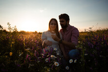 Romantic Couple, Sitting In The Meadow, Embracing Outdoors