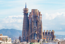 """Facade Of Unfinished Sacred Family """"La Sagrada Familia"""" , Cathedral Designed By Gaudi, Being Built Since 19 March 1882 With People Donations. The Text """"Sanctus"""" In The Facade Means Saint"""