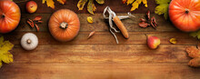 A Thanksgiving Autumn Harvest Background Of Pumpkins, Pears, Leaves And Corncobs On A Rustic Wooden Table With Copy Space.