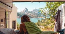 Traveling Woman In Camper Near Lake In Mountains
