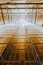 Glass Facades Of Geometric Futuristic Skyscrapers In Modern City