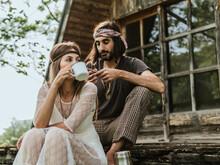 Hippie Man Sharing Coffee With Beautiful Hippie Girl