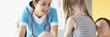 Leinwandbild Motiv Woman doctor examining little girl at appointment in clinic
