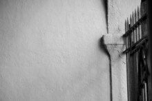 Black And White - Stucco Wall With Fence Background