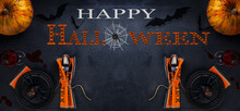 Halloween Panoramic Banner, A Glass With Red Bloody Smudges, A Black Scary Spider On Top And Cutlery In A Napkin On A Black Background With Copy Space. Happy Halloween Sign. Top View.