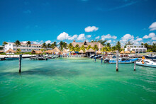 Cancun, Mexico. May 30, 2021. Luxury Hotels And Resorts With Moored Yachts Or Sailboat On Sea Water Surface