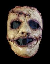 Crazed Killer Mask Isolated Against Black Background
