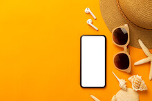 Summer Background With Blank Screen Phone And Beach Accessories - Sunglasses, Straw Hat On Vibrant Orange Background Top View With Copy Space.