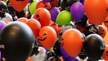 Orange, Black, Green And Purple Balloons, With A Fun Halloween Theme.