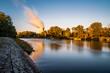 canvas print picture - Blick auf das AKW, Atomkraftwerk, Kernkraftwerk Gundremmingen mit Kühlturm und Verdunstungswolke vor blauem Himmel, warme Farben