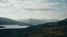 Clouds Over The Mountains And Lochs