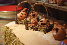 Home Decoration. Clay Doll In The Basket