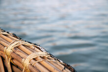 A Bamboo Boat Tied Tightly With String Over The River