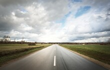 Empty Highway (asphalt Road) Through The Fields. Dramatic Sky Before The Rain And Thunderstorm. Concept Landscape. Rural Scene. Darkness, Fall Season, Fickle Weather, Dangerous Driving, Road Trip