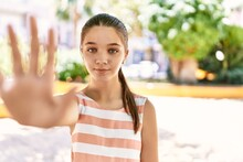 Young Teenager Girl Outdoors On A Sunny Day With Open Hand Doing Stop Sign With Serious And Confident Expression, Defense Gesture