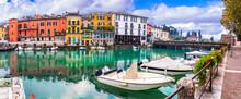 Idyllic Lake Scenery - Tranquil Beautiful Village (town) Peschiera Del Garda With Fishing Boats And Colorful Houses. Lago Di Garda, Northern Italy